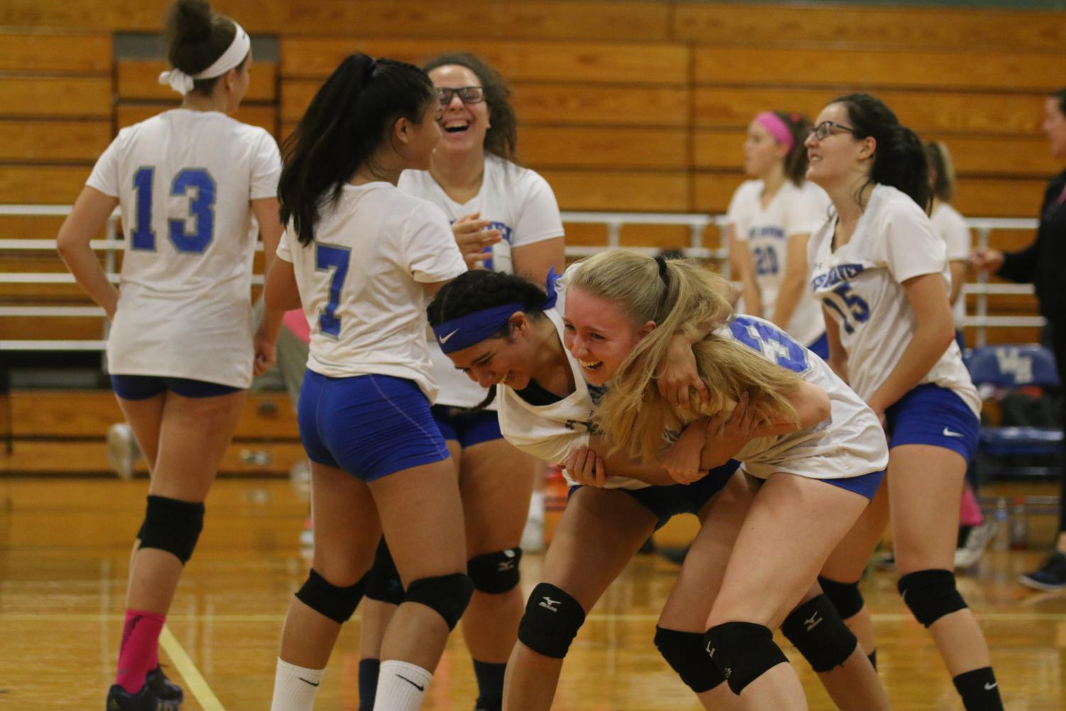 The Westies celebrate after senior Kara Erickson makes a good hit in an October match against Lyman Hall.