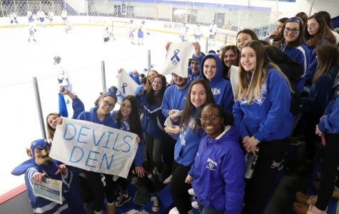 The Bomb Squad cheers on the Blue Devils at Tuesday night's game.