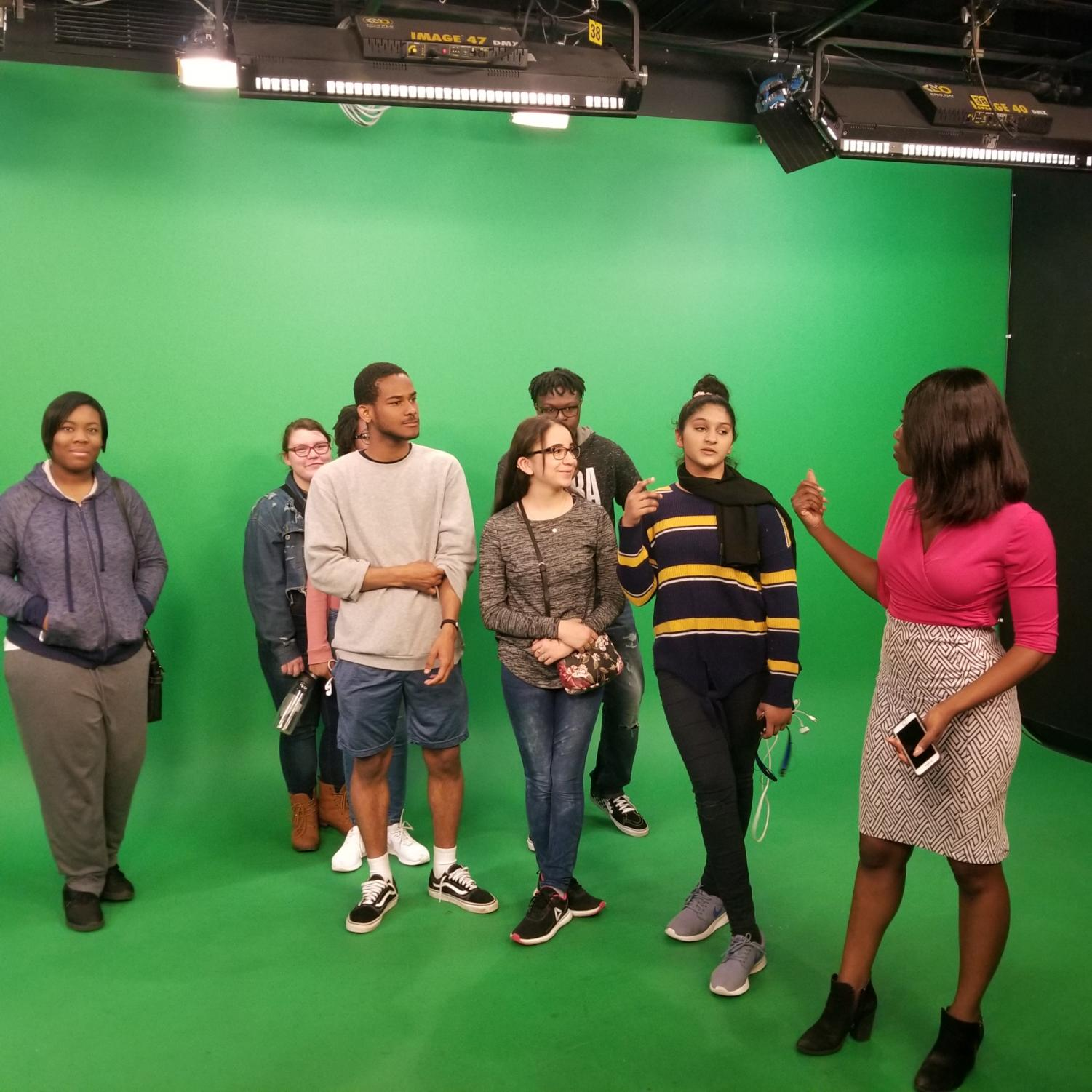 The+group+on+the+green+screen+where+the+meteorologist+works.