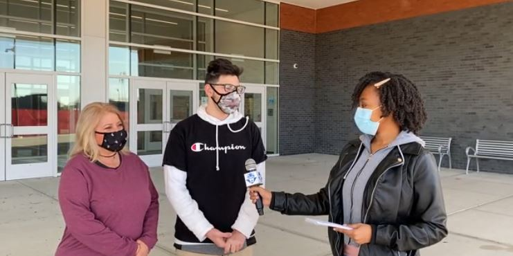 Reporter Rodjae Smith interviews sophomore Dominic Konareski and his mother, Michelle Konareski, about the student health center in a video aired by Fox 61 Student News.