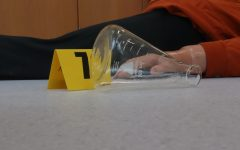 Students are investigating a crime scene in Mrs. Hartsoe's science class.